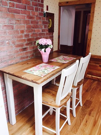 West Harwich Cape Cod vacation rental - Breakfast nook with counter table and 2 stools