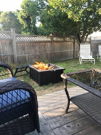 West Yarmouth Cape Cod vacation rental - Back yard with fire pit