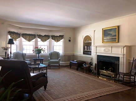 Harwich Port Cape Cod vacation rental - Spacious fire placed living room with two seating areas