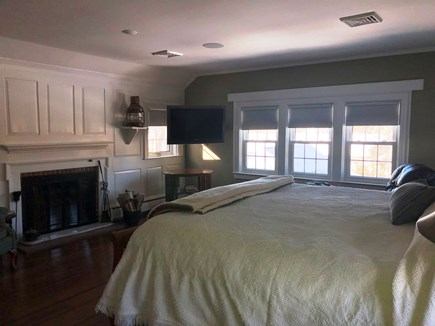 Harwich Port Cape Cod vacation rental - Master bedroom with fireplace & spacious en suite bathroom