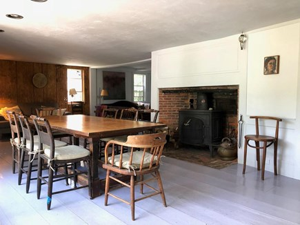 Wellfleet Cape Cod vacation rental - The dining room off the kitchen, with the wood burning stove.