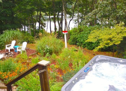 Orleans Cape Cod vacation rental - View from spa to fire pit to pond