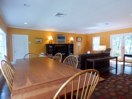 South Orleans on Pleasant Bay Cape Cod vacation rental - Main House Family Room with TV and Slider out to the Deck