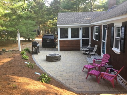 Chatham Cape Cod vacation rental - Back yard of the Cottage with firepit, BBQ grill, & spacious pati