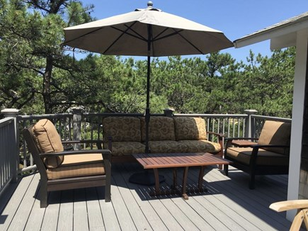 Eastham Cape Cod vacation rental - Comfortable seating at the back of the wrap-around deck