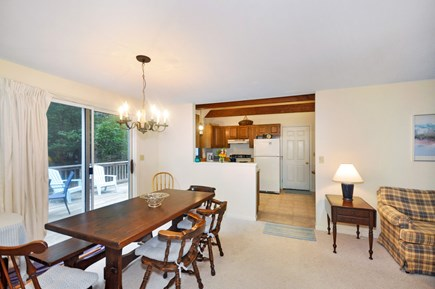 Eastham Cape Cod vacation rental - Dining area facing east, slider to deck, kitchen pass through