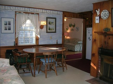 Chatham Cape Cod vacation rental - Living room and dining area with fireplace