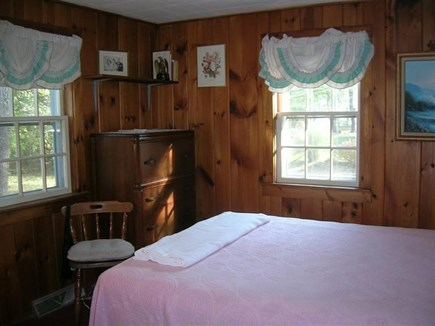 Chatham Cape Cod vacation rental - Knotty pine bedroom with queen size bed on first floor.