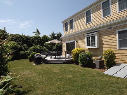 Chatham Cape Cod vacation rental - Back Yard & Deck with Dining Table and Gas Grill