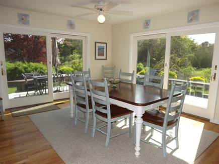 Chatham Cape Cod vacation rental - Dining Area with Glass Doors to Wrap-Around Deck