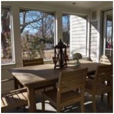 Osterville Osterville vacation rental - Outdoor cottage table with entry to family room and pool area.