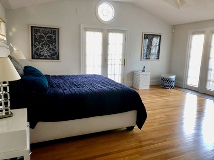 Brewster Cape Cod vacation rental - Spacious master bedroom with balcony and windows facing pond