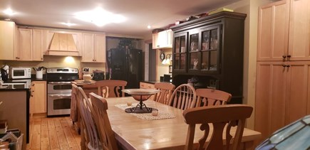 Dennisport Cape Cod vacation rental - Large Eat In Kitchen with glass slider to 20x 20 deck