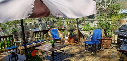 Dennisport Cape Cod vacation rental - View of 20 x 20 deck from kitchen slider, firepit on stone patio
