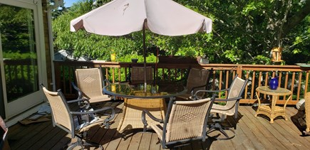 Dennisport Cape Cod vacation rental - 20x20 deck visable from kitchen for combined entertainment, night