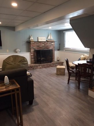 EASTHAM Cape Cod vacation rental - Fireplace in the lower level.