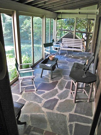 Brewster Cape Cod vacation rental - Screened in porch off the end of the house,  Great for chillin'.