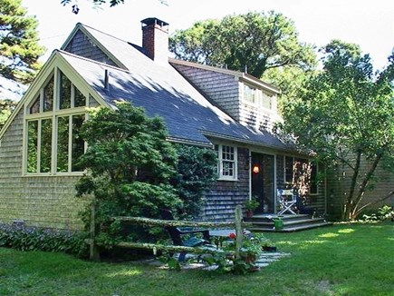 Brewster Cape Cod vacation rental - In the back of the cottage, there's a patio and garden beds.