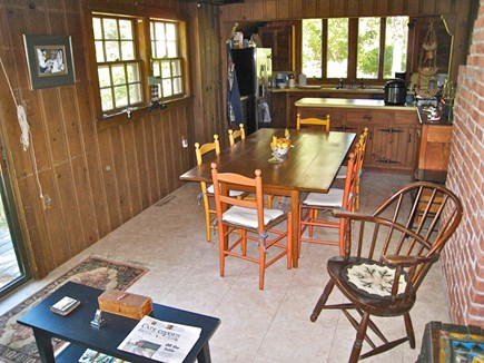 Brewster Cape Cod vacation rental - The dining table seat 10 - counter and kitchen at the far end.