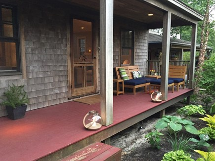 Provincetown Cape Cod vacation rental - Covered porch is surrounded by beautiful gardens in the summer