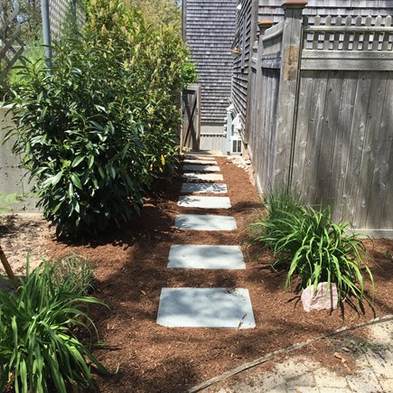 Provincetown Cape Cod vacation rental - Path to large, private outdoor shower and bike storage area