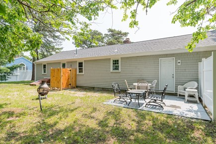 West Yarmouth Cape Cod vacation rental - Back yard with BBQ and seating for six