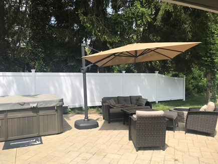 Falmouth Cape Cod vacation rental - Patio off the living room. Hot tub, seating area, fire pit and TV
