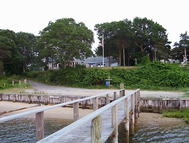 West Dennis Cape Cod vacation rental - Small public dock - bottom of the hill.  Our house in background.
