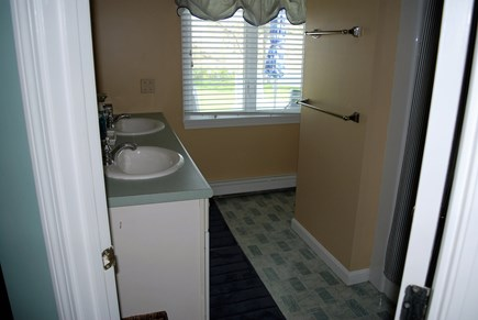 West Dennis Cape Cod vacation rental - Master bath with 2 sinks and tub/shower.
