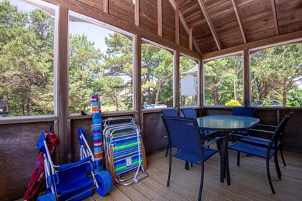 Eastham Cape Cod vacation rental - Screened porch with beach stuff!