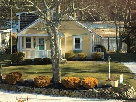 Pocasset Pocasset vacation rental - View of house and backyard from street.