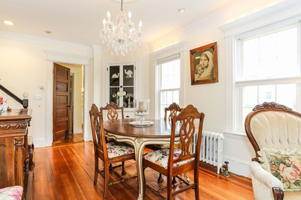 Bourne, Sagamore / Sandwich Line Cape Cod vacation rental - Enjoy your meal below a gorgeous chandelier.