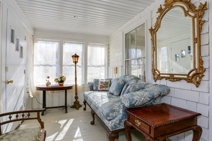 Bourne, Sagamore / Sandwich Line Cape Cod vacation rental - 3-season porch with plenty of seating to enjoy a drink & a book.
