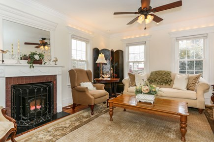 Bourne, Sagamore / Sandwich Line Cape Cod vacation rental - Living room with electric fireplace & desk for your laptop!