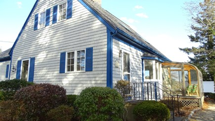 Harwich port Cape Cod vacation rental - Side view of house, showing sun room