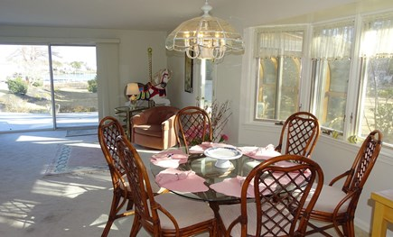 Harwich port Cape Cod vacation rental - Dining area from kitchen, showing sliders to deck, water view