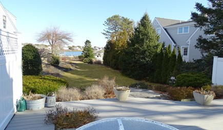Harwich port Cape Cod vacation rental - Large deck facing the yard that leads to the water