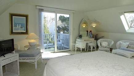 Harwich port Cape Cod vacation rental - Upstairs king master with TV and deck, facing the water