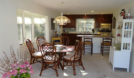 Harwich port Cape Cod vacation rental - Dining area adjacent to kitchen with breakfast bar