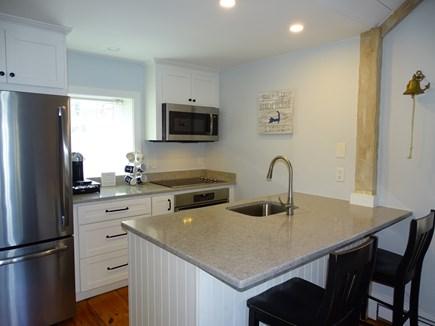 New Seabury, Mashpee Cape Cod vacation rental - Kitchen with new stainless steel appliances, breakfast bar
