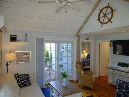 New Seabury, Mashpee Cape Cod vacation rental - Vaulted living room with ceiling fan, slider to patio, TV