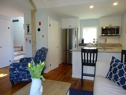 New Seabury, Mashpee Cape Cod vacation rental - Living area opens to kitchen, showing stairs to twin bedroom