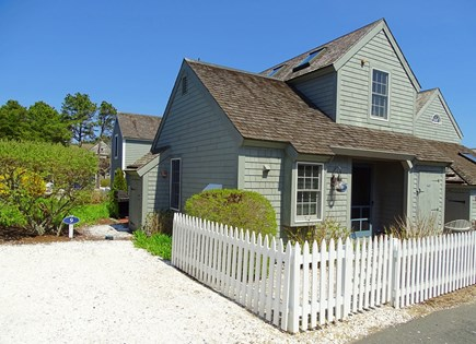 New Seabury, Mashpee Cape Cod vacation rental - Front of house, showing parking space & entrance to back patio