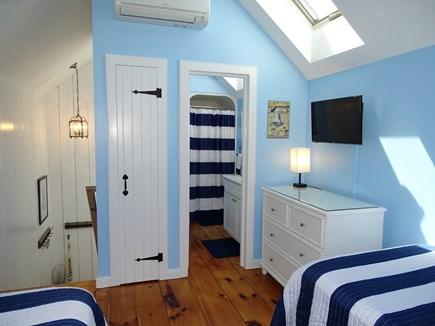 New Seabury, Mashpee Cape Cod vacation rental - Bright twin bedroom showing TV and bathroom