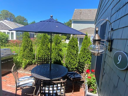 New Seabury, Mashpee Cape Cod vacation rental - Enjoy sun and shade on back patio with grill and dining