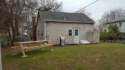 Dennis Cape Cod vacation rental - Backyard with Grill, Picnic Table, and Outdoor Shower