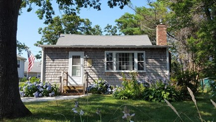 Dennis Cape Cod vacation rental - Exterior home with front yard in bloom