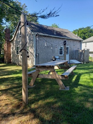 Dennis Cape Cod vacation rental - Spacious backyard with gas grill, picnic table and outdoor shower