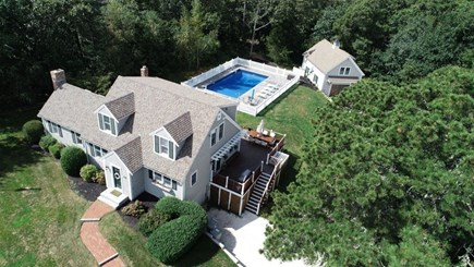 East Orleans Cape Cod vacation rental - Aerial View of property. Main house, pool, and carriage.