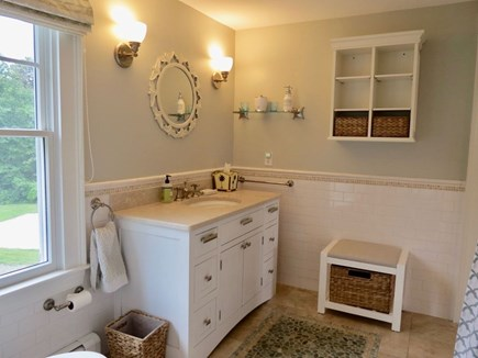 East Orleans Cape Cod vacation rental - Master bath w/tub shower and plenty of storage.
